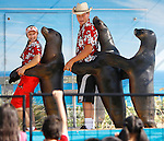 Galina Rogacheva, left, and Surfer Joe entertain the crowd with their sea lions while dancing in a conga line at the 63rd Riverside County Fair and National Date Festival in Indio on Friday, February 13, 2009.