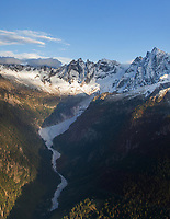 Switzerland. Canton Graubunden. Bregaglia valley. Aerial view on the mountains above  Bondo. The village was hit by three massive landslides caused by a giant rockslide swept down from Piz Cengalo on August 23, 2017. Right to left: The mountains' names are Piz Badile (3308 m), Piz Cengalo (3369m), Piz dei Gemelli (3259), Sciora Dadent (or Sciora di Dentro) (3,275 m). 20.09.2017 © 2017 Didier Ruef