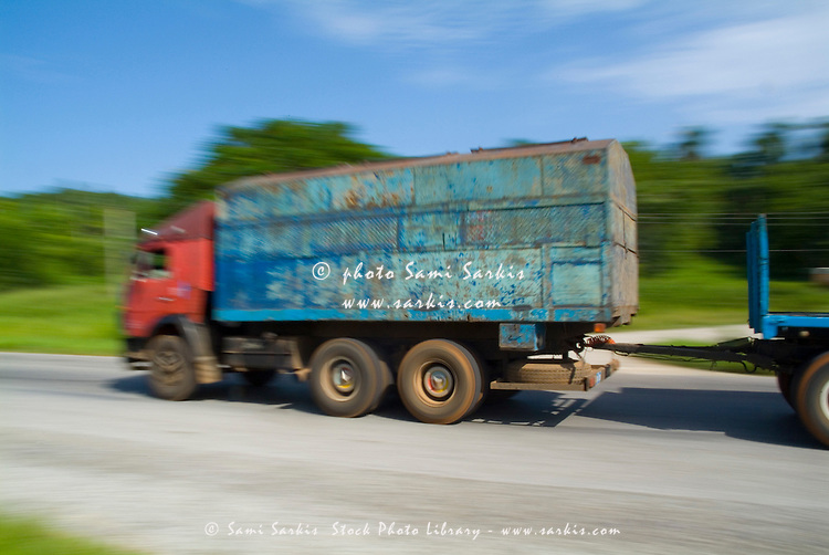 Truck speeding along the highway between Havana and Pinar del Rio, Cuba.