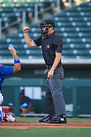 Home plate umpire Michael Corbett calls a strike during an Arizona League game between the AZL Padres 1 and the AZL Cubs 1 on July 5, 2019 at Sloan Park in Mesa, Arizona. The AZL Cubs 1 defeated the AZL Padres 1 9-3. (Zachary Lucy/Four Seam Images)