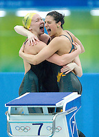 14 AUG 2008 - BEIJING, CHN - Kylie Palmer, Stephanie Rice and Bronte Barratt (hidden) celebrate the Australian teams victory in the 4x200m Relay -  Beijing Olympics. (PHOTO (C) NIGEL FARROW) *** IOC RULES APPLY ON USAGE ***
