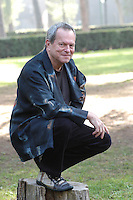 """TERRY GILLIAM.Photocall for the film """"Tideland"""", Rome, Italy..October 29th, 2007 .full length black jacket kneeling crouching .CAP/CAV.©Luca Cavallari/Capital Pictures."""