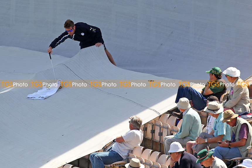 Spectators look on as a jumper is retrieved from the sight screen area using a golf club - Hampshire CCC vs Essex CCC - LV County Championship Division Two Cricket at the Ageas Bowl, West End, Southampton - 17/06/14 - MANDATORY CREDIT: Gavin Ellis/TGSPHOTO - Self billing applies where appropriate - 0845 094 6026 - contact@tgsphoto.co.uk - NO UNPAID USE