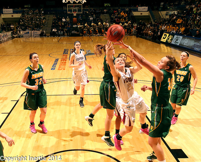 SIOUX FALLS, SD - MARCH 8: Katie Comello #22 from IUPUI has her shot blocked by Emily Spier #30 from NDSU in the second half of their quarterfinal game Saturday afternoon at the 2014 Summit League Championship in Sioux Falls, SD. (Photo by Dave Eggen/Inertia)