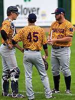 GREEN BAY - June 2015: Kenosha Kingfish catcher Alex Dunlap (50), pitcher E.J. Trapino (45) and /KF20/ during a Northwoods League game against the Green Bay Bullfrogs on June 21st, 2015 at Joannes Park in Green Bay, Wisconsin. Green Bay defeated Kenosha 10-7. (Brad Krause/Krause Sports Photography)