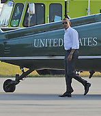 United States President Barack Obama arrives at Martha's Vineyard Airport in West Tisbury, MA on August 18, 2011 for his summer vacation..Credit: Rick Friedman / Pool via CNP