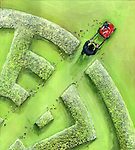 Businessman breaking maze by a lawn mower