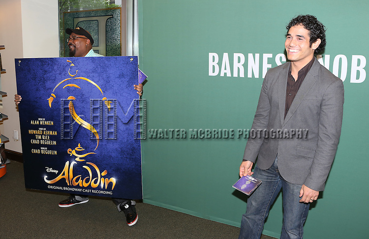 James Monroe Iglehart  and Adam Jacobs visit 'Aladin' Broadway Cast CD Signing at Barnes & Noble Citigroup Center on June 20, 2014 in New York City.