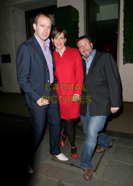 TIM VINE, GUEST & ROLAND RIVERON.Comic Relief does Fame Academy Wrap Party, Mayfair Hotel, London, UK..March 28th, 2007.full length black coat pinstripes blue suit red jeans denim .CAP/AH.©Adam Houghton/Capital Pictures