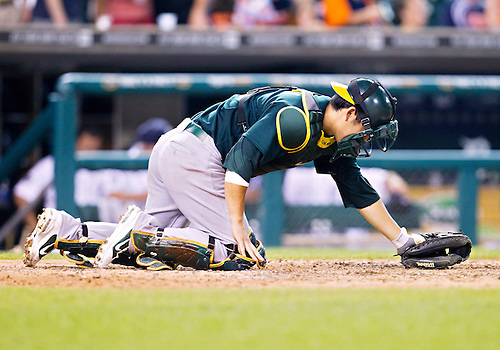July 20, 2011:  Oakland Athletics catcher Kurt Suzuki (#8) manicures the field at home plate during MLB game action between the Oakland Athletics and the Detroit Tigers at Comerica Park in Detroit, Michigan.  The Athletics defeated the Tigers 7-5.