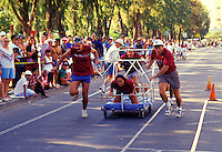 Participants at the Honolulu International Bed Race with spectators looking on, Kapiolani Park, Honolulu
