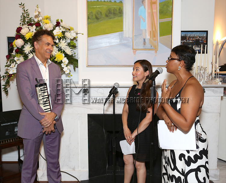 Brian Stokes Mitchell, Di Ana Pisarri and Schele Williams attend 'Parlor Night' A benefit evening for The Broadway Inspirational Voices Outreach Program at the home of Roy and Jenny Neiderhoffer on June 22, 2015 in New York City.