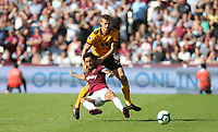 West Ham United's Felipe Anderson and Wolverhampton Wanderers' Ryan Bennett<br /> <br /> Photographer Rob Newell/CameraSport<br /> <br /> The Premier League - West Ham United v Wolverhampton Wanderers - Saturday 1st September 2018 - London Stadium - London<br /> <br /> World Copyright © 2019 CameraSport. All rights reserved. 43 Linden Ave. Countesthorpe. Leicester. England. LE8 5PG - Tel: +44 (0) 116 277 4147 - admin@camerasport.com - www.camerasport.com