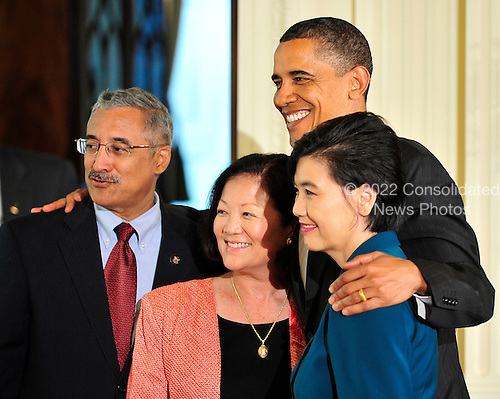 United States President Barack Obama poses for a photo as he departs a reception to celebrate Asian American and Pacific Islander Heritage Month in the East Room of the White House in Washington, D.C. on Monday, May 24, 2010.  From left to right: U.S. Representative Bobby Scott (Democrat of Virginia), U.S. Representative Mazie Hiron (Democrat of Hawaii), President Obama, and U.S. Representative Judy Chu (Democrat of California)..Credit: Ron Sachs / Pool via CNP