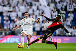Lucas Vazquez of Real Madrid (L) fights for the ball with Abdoulaye Ba, A Ba, of Rayo Vallecano during the La Liga 2018-19 match between Real Madrid and Rayo Vallencano at Estadio Santiago Bernabeu on December 15 2018 in Madrid, Spain. Photo by Diego Souto / Power Sport Images