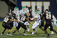 1 September 2011:  FIU's defense (pictured, linebacker Christopher Edwards (56), defensive back Justin Halley (32), defensive back Tevin Blanchard (29)) converges on North Texas quarterback Brent Osborn (11) in the second half as the FIU Golden Panthers defeated the University of North Texas, 41-16, at University Park Stadium in Miami, Florida.