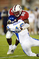 Louis Hobson makes a sack during Stanford's 63-26 win over San Jose State on September 14, 2002 at the Stanford Stadium in Stanford, CA.<br />