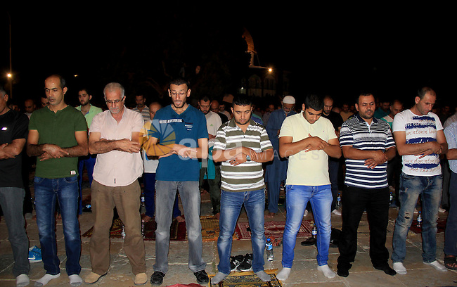 "Palestinian Muslim worshippers perform ""Taraweeh"", nightly prayer of the month of Ramadan, in front of the Dome of the Rock mosque, in Jerusalem's old city on June 25, 2016. Ramadan is sacred to Muslims because it is during that month that tradition says the Koran was revealed to the Prophet Mohammed. The fast is one of the five main religious obligations under Islam. More than 1.5 billion Muslims around the world will mark the month, during which believers abstain from eating, drinking, smoking and having sex from dawn until sunset. Photo by Mahfouz Abu Turk"