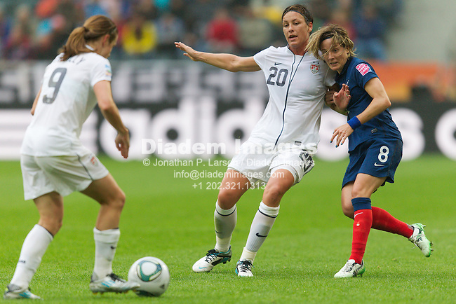 MOENCHENGLADBACH, GERMANY - JULY 13:  Abby Wambach of the United States (20) and Sonia Bompastor of France (8) push each other during a FIFA Women's World Cup semifinal match at Stadion im Borussia Park on July 13, 2011  in Moenchengladbach, Germany.  Editorial use only.  Commercial use prohibited.  No push to mobile device usage.  (Photograph by Jonathan P. Larsen)