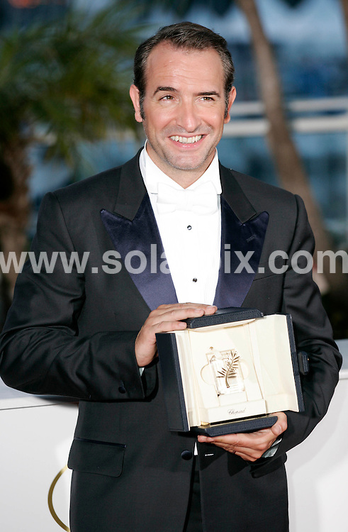 **ALL ROUND PICTURES FROM SOLARPIX.COM**                                             **UK AND SPAIN SYNDICATION RIGHTS ONLY**                                                                                  Caption: Golden Globe awards winner´s photocall at the  64th Cannes Film Festival in France.                                                                              This pic: Jean Dujardin                                                                                             JOB REF:13418        CPR/Heinz       DATE:23.05.2011                                                          **MUST CREDIT SOLARPIX.COM OR DOUBLE FEE WILL BE CHARGED**                                                                      **MUST AGREE FEE BEFORE ONLINE USAGE**                               **CALL US ON: +34 952 811 768 or LOW RATE FROM UK 0844 617 7637**