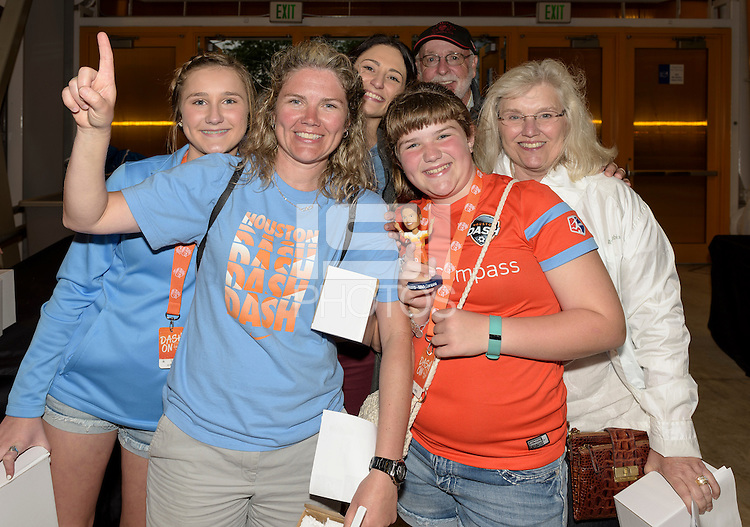 Houston Dash fans show off their Carli Lloyd bobblehead given away at the entrance gates in Houston's game against the Chicago Red Stars on Saturday, April 16, 2016 at BBVA Compass Stadium in Houston Texas.
