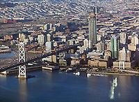 aerial photograph of San Francisco Oakland Bay Bridge toward San Francisco One Rincon hill residential towerr under construction