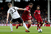 17th March 2019, Craven Cottage, London, England; EPL Premier League football, Fulham versus Liverpool; Adam Lallana of Liverpool takes on Joe Bryan of Fulham