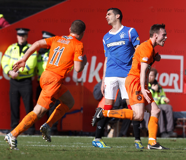 Keith Watson celebrates his goal for Dundee Utd as Salim Kerkar turns away in anguish