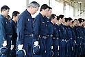 March 11, 2016, Tokyo, Japan - Police officers offer silent prayers for the tsunami and earthquake victims after they searched remains of missing people at Namie in Fukushima prefecture near the crippled TEPCO's nuclear plant on Friday, March 11, 2016 on the fifth anniversary of the East Japan Great Earthquake.  (Photo by Yoshio Tsunoda/AFLO) LWX -ytd-