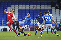 Fleetwood Town's Kyle Dempsey (left) in action with Oldham Athletic's Dan Gardner (right) during the Sky Bet League 1 match between Oldham Athletic and Fleetwood Town at Boundary Park, Oldham, England on 26 December 2017. Photo by Juel Miah / PRiME Media Images.
