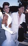 Hugh Hefner and Carrie Lee attend Benefit for Alan Cranston on September 6, 1986 at Barbra Streisand's home in Malibu, California.