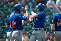 Jake Cronenworth (1) of the Durham Bulls high fives teammate Nick Ciuffo (19) after hitting a home run against the Charlotte Knights at BB&T BallPark on May 27, 2019 in Charlotte, North Carolina. The Bulls defeated the Knights 10-0. (Brian Westerholt/Four Seam Images)
