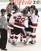Brittany Esposito (NU - 7), Paige Savage (NU - 28), Tori Hickel (NU - 55), Maggie Brennolt (NU - 22) - The Northeastern University Huskies defeated Boston College Eagles 4-3 to repeat as Beanpot champions on Tuesday, February 12, 2013, at Matthews Arena in Boston, Massachusetts.