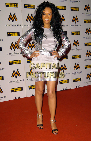 KANYA KING.The MOBO (Music Of Black Origin) Awards 2007 at the O2 Arena, London, England. .September 19th, 2007 .mobos full length grey gray silver dress jacket sparkly hands on hips .CAP/CAN.©Can Nguyen/Capital Pictures