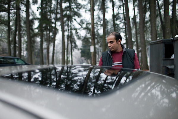 December 16, 2010. Raleigh, NC.. TP Mishra locks his car at his apartment complex after picking up his wife from one job and dropping her at the next. He does this nearly everyday before having the start work at 1 AM.. TP Mishra, a refugee from Bhutan, has recently relocated from the Bronx to Raleigh, where he lives in an suburban apartment  with his wife, as well as another Bhutanese couple.