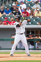 Micah Johnson (3) of the Charlotte Knights at bat against the Pawtucket Red Sox at BB&T Ballpark on August 8, 2014 in Charlotte, North Carolina.  The Red Sox defeated the Knights  11-8.  (Brian Westerholt/Four Seam Images)