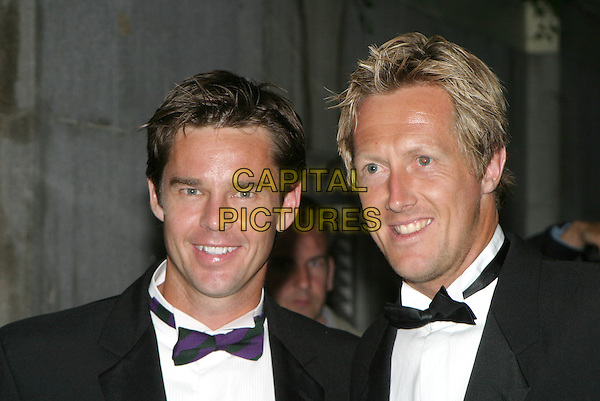 TODD WOODBRIDGE & JONAS BJORKMAN.Leaving the Wimbledon Champions dinner at the Savoy Hotel, London,.4th July 2004..portrait headshot.www.capitalpictures.com.sales@capitalpictures.com.©Capital Pictures