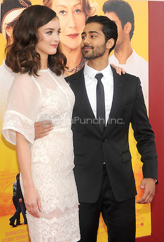 New York, NY- August 4: Actress Charlotte Le Bon and Manish Dayal attend the world premiere of Dreamworks pictures' 'The Hundred-Foot Journey' on August 4, 2014 at the Ziegfeld Theater in New York City. Credit: John Palmer/MediaPunch