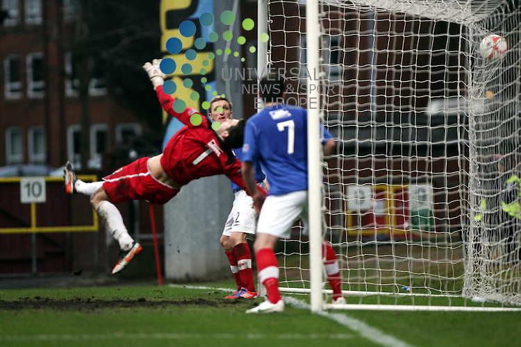 Partick Thistle v Cowdenbeath.Irn Bru 1st Division.Saturday 26th Jan 2013.Firhill Stadium -- Score 2-1.Conrad Balatoni hits the winner past Thomas Flynn.Photo by Tommy Taylor Universal News and Sport