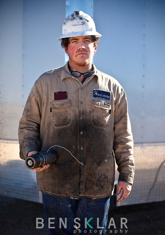 Steven Dykes works on fracking equipment for Wildcat Wireline on a Goodrich Oil Co field  on the Burns Ranch near Dilley, Texas on Tuesday, January 3, 2012...Ben Sklar