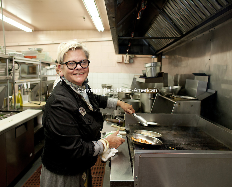WOODBURY, CT-7 November 2013-110713BF04- Chef Carol Peck prepares a dish inside the kitchen of her Woodbury restaurant. She is celebrating the 20th Anniversary of Carol Peck's Good News Cafe, which opened in Woodbury in 1992.   Bob Falcetti Republican-American