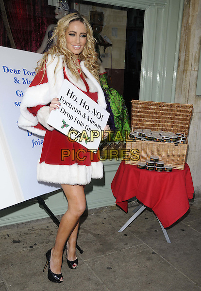 Chantelle Houghton.The PETA photocall to protest against the store Fortnum & Mason's continued sale of Foie Gras, Fortnum & Mason, Piccadilly, London, England..December 22nd, 2011.full length red white fur dress cape  trim santa claus peep toe shoes black ho ho no drop.CAP/CAN.©Can Nguyen/Capital Pictures.