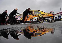 Oct. 31, 2009; Talladega, AL, USA; Crew members push the car of NASCAR Sprint Cup Series driver Matt Kenseth through the garage following the cancelling of qualifying for the Amp Energy 500 at the Talladega Superspeedway. Qualifying was cancelled due to rain. Mandatory Credit: Mark J. Rebilas-