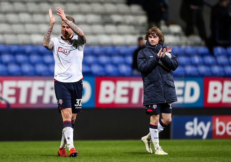 Bolton Wanderers' David Wheater and Luca Connell applaud the home supporters<br /> <br /> Photographer Andrew Kearns/CameraSport<br /> <br /> The EFL Sky Bet Championship - Bolton Wanderers v Middlesbrough -Tuesday 9th April 2019 - University of Bolton Stadium - Bolton<br /> <br /> World Copyright © 2019 CameraSport. All rights reserved. 43 Linden Ave. Countesthorpe. Leicester. England. LE8 5PG - Tel: +44 (0) 116 277 4147 - admin@camerasport.com - www.camerasport.com