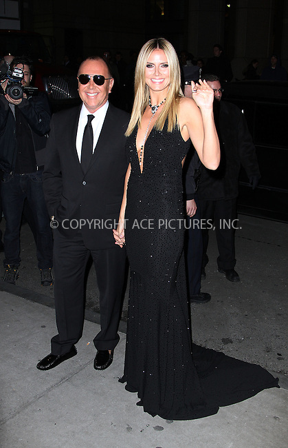 WWW.ACEPIXS.COM....February 6 2013, New york City....Michael Kors and Heidi Klum arriving at the amfAR New York Gala To Kick Off Fall 2013 Fashion Week at Cipriani Wall Street on February 6, 2013 in New York City.....By Line: Zelig Shaul/ACE Pictures......ACE Pictures, Inc...tel: 646 769 0430..Email: info@acepixs.com..www.acepixs.com