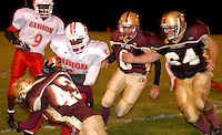 Albion running back junior Durant Crum is stopped by Western, from left, sophomore linebacker Jason Crawford, defensive back  Brandon Casto and senior defensive lineman Phillip Zerull during the second quarter at Western on September 29, 2006..photo by Danny Gawlowski