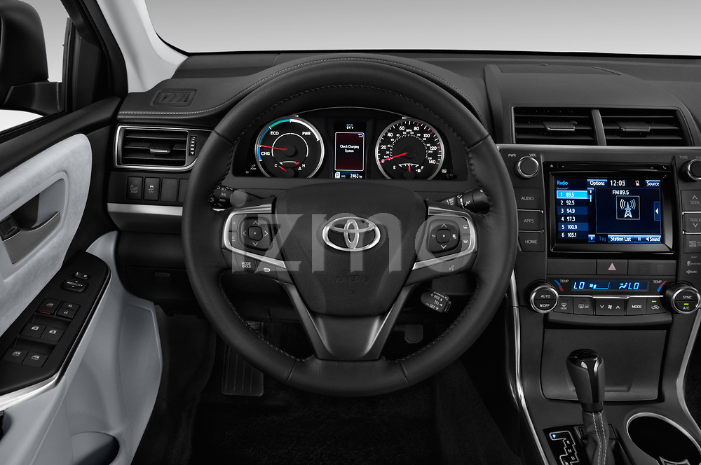 Car pictures of steering wheel view of a 2015 Toyota camry hybrid 4 Door Sedan