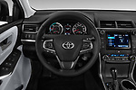 Car pictures of steering wheel view of a 2015 Toyota camry hybrid 4 Door Sedan