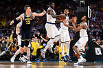 SAN ANTONIO, TX - APRIL 02: Eric Paschall #4 of the Villanova Wildcats rebounds the ball against Moritz Wagner #13 of the Michigan Wolverines during the second half of the 2018 NCAA Men's Final Four National Championship game at the Alamodome on April 2, 2018 in San Antonio, Texas.  (Photo by Jamie Schwaberow/NCAA Photos via Getty Images)