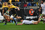 9th June 2017, Westpac Stadium, Wellington, New Zealand; Super Rugby; Hurricanes versus Chiefs;  Hurricanes' Beauden Barrett (L) is tackled by Chiefs' Tawera Kerr-Barlow